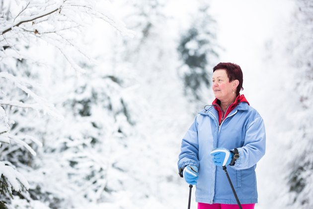 Middle age woman cross-country skiing