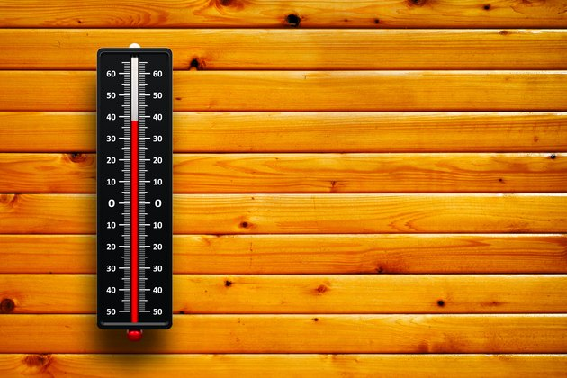 3d Thermometer heat on wood background