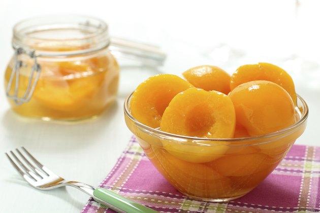 peach syrup in glass jar
