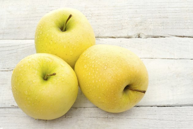 three golden delicious apples