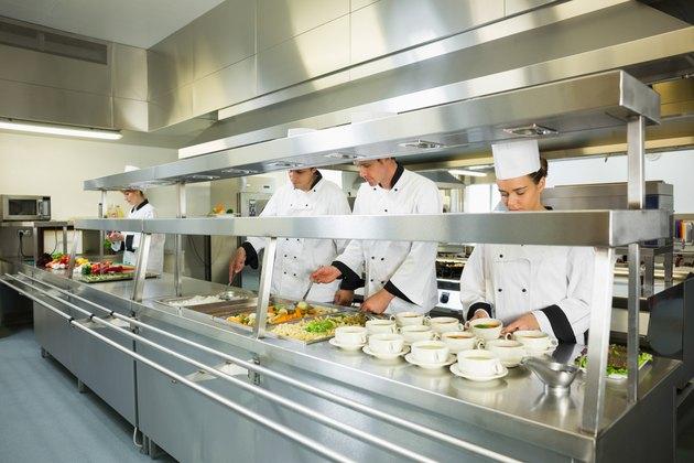 Four chefs working in a big kitchen