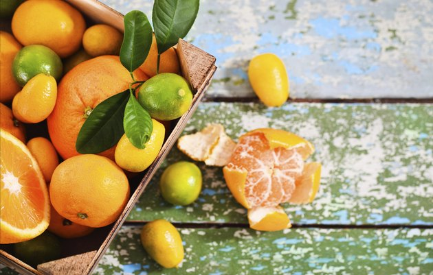Fresh citrus fruits in the wooden box