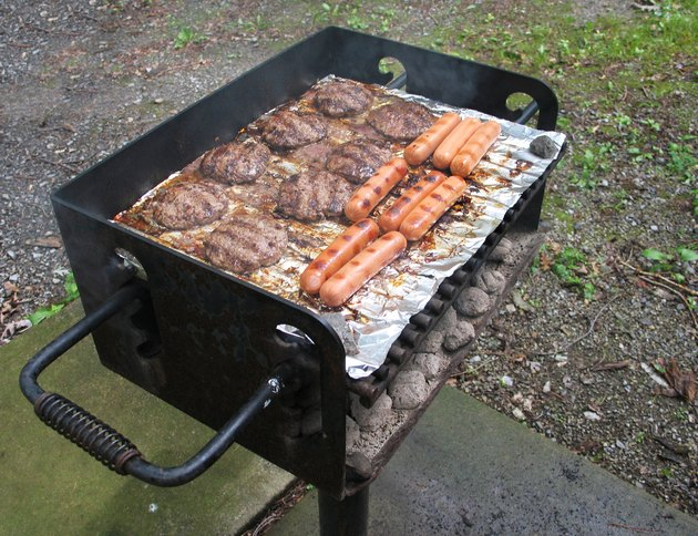 Meat cooking on charcoal grill
