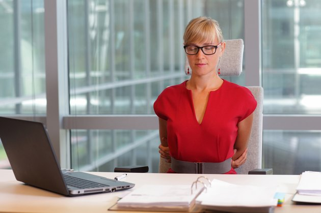 caucasian business woman in eyeglasses relaxing