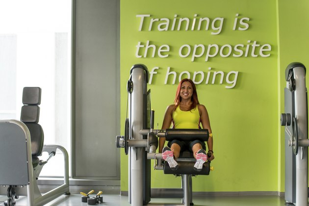 Sporty woman exercising in a fitness center
