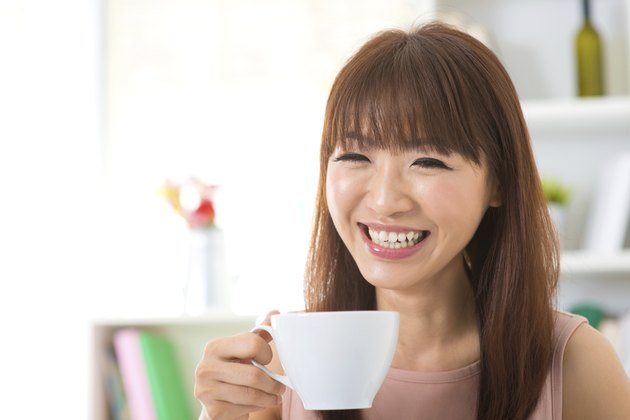 Asian woman enjoying coffee