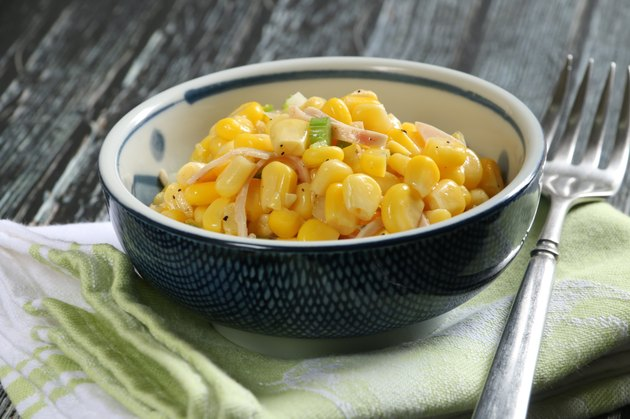 Corn Salad in Bowl on Rustic Wooden Table