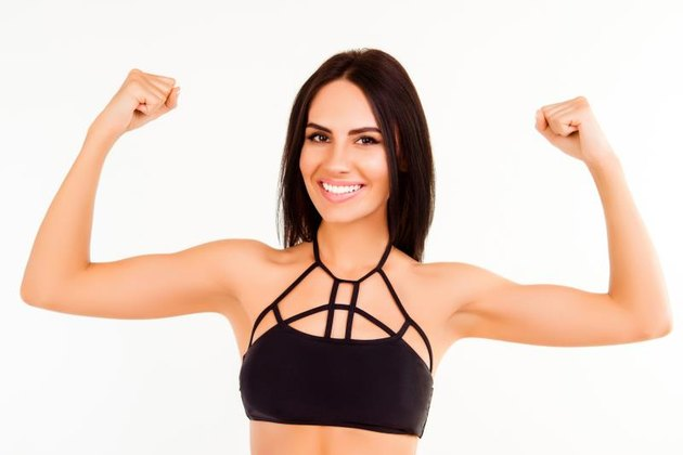 Healthy fit young woman demonstrating her strong arms