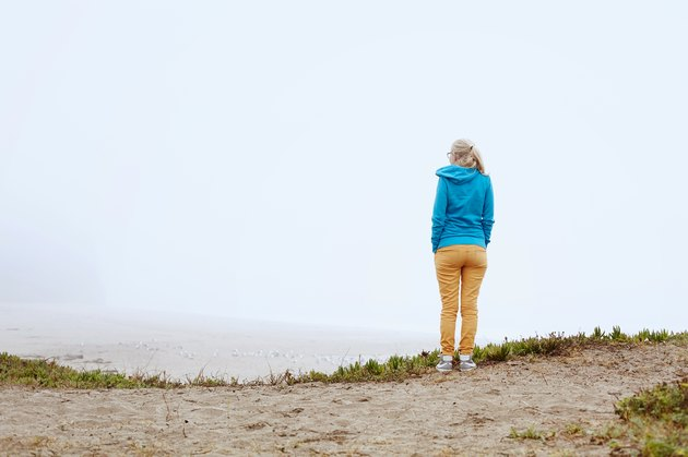 Girl on foggy beach