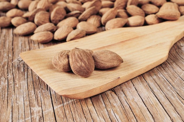 shelled almonds on a wooden table
