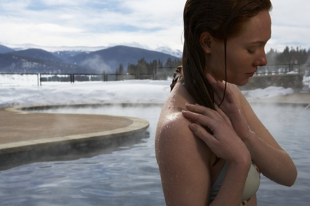 Young woman in hot springs, close-up