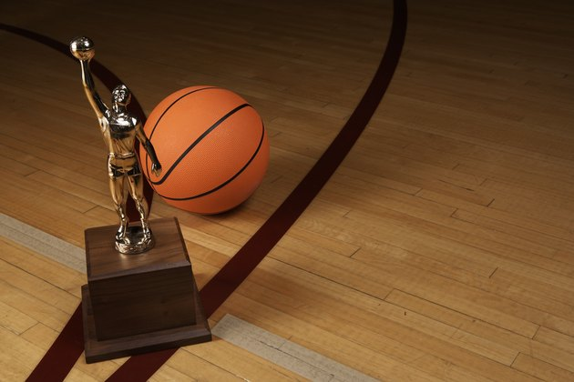 Basketball and trophy on basketball court, elevated view