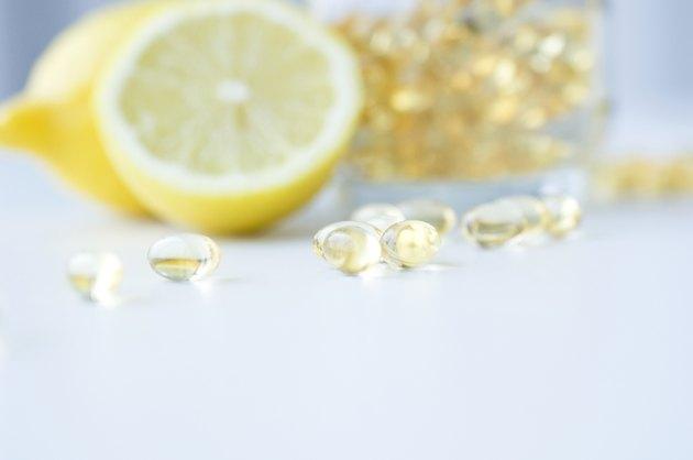 Vitamin capsules and lemons