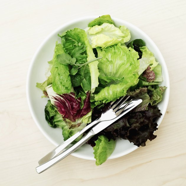 Elevated view of fresh salad greens in a bowl