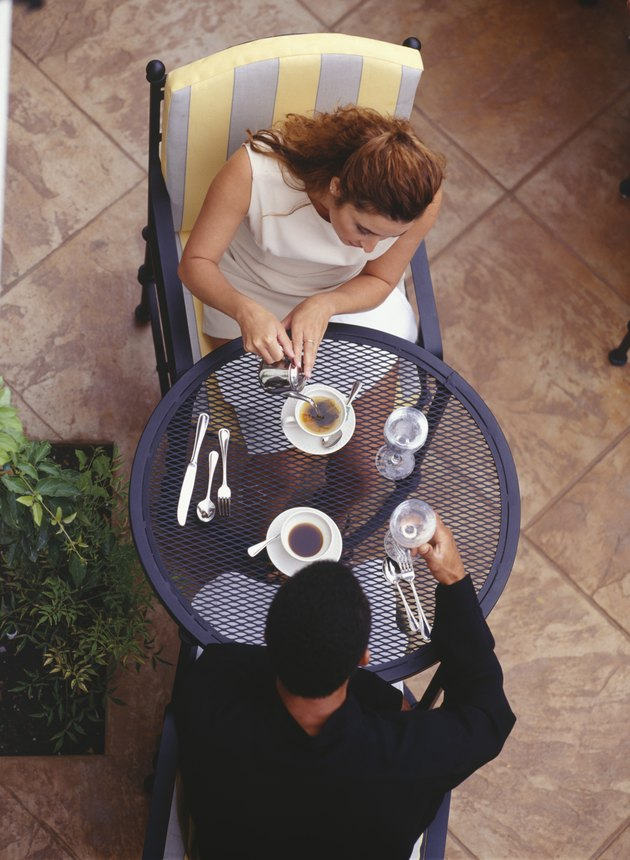 Couple sitting at outdoor cafe, elevated view