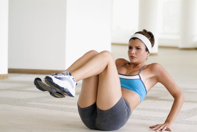 Young woman exercising on the floor