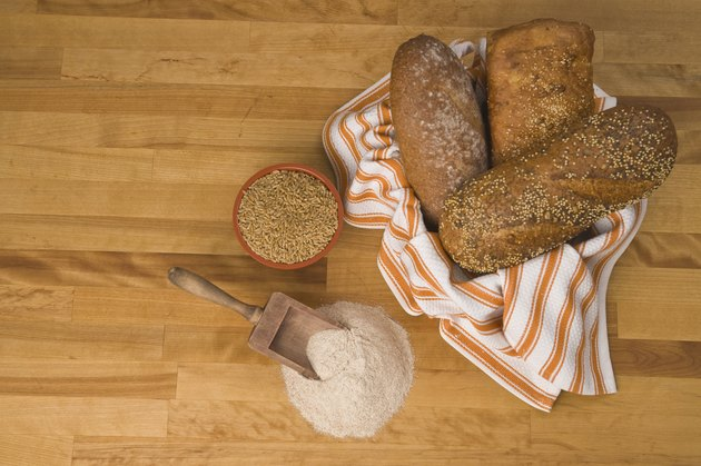 bread with grain and wheat on counter