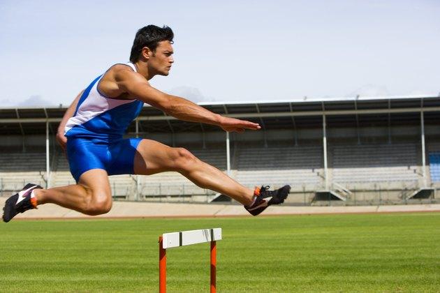 Man jumping a hurdle