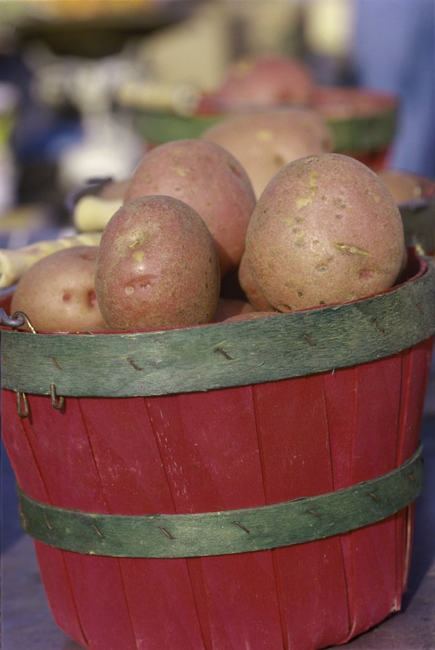 Close-up of potatoes in a wooden bucket