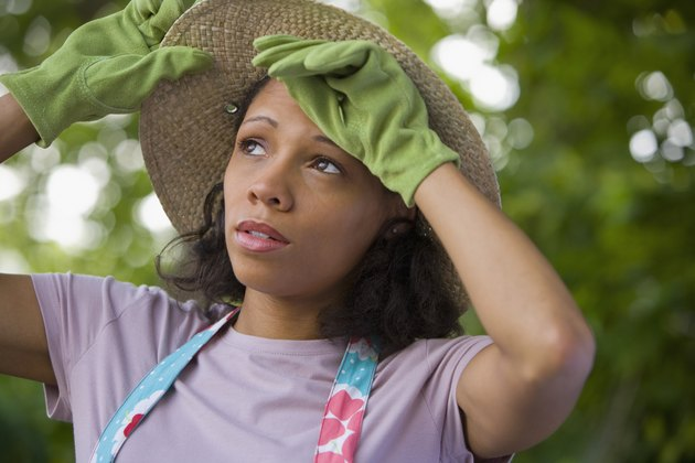 African American woman wearing gardening gloves