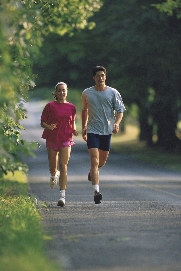Couple running down road