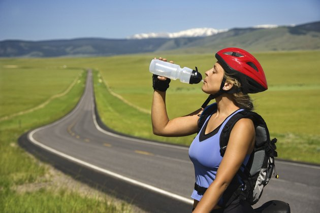 Woman cyclist drinking water