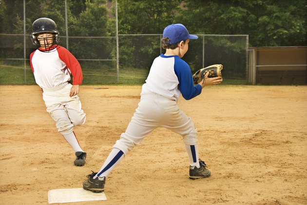 Young boys playing in baseball game