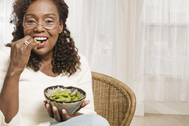 Woman eating edamame