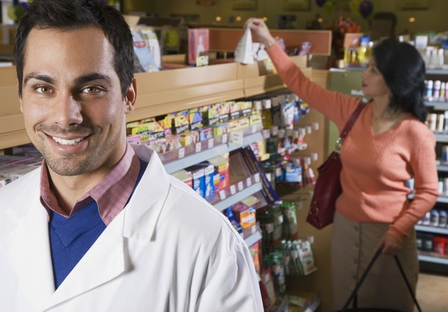 Pacific Islander pharmacist in front of customer