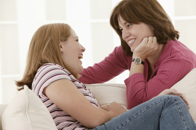 Mother and teenage daughter talking
