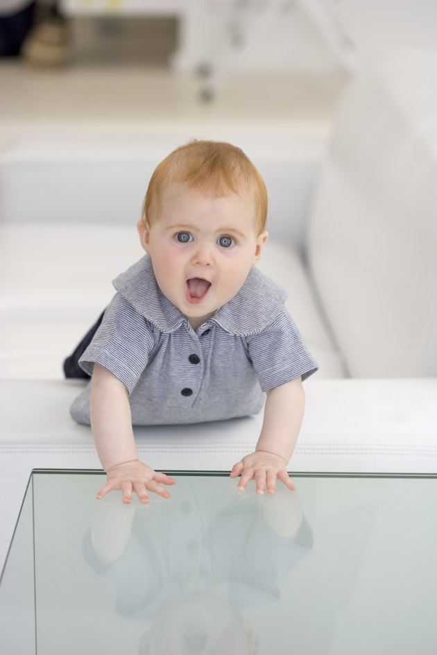 Baby with hands on glass
