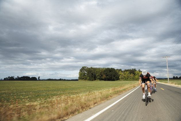 Road cyclists in action, front view
