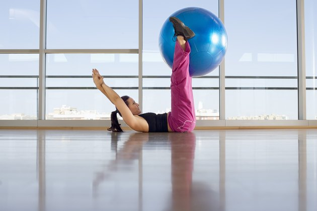 Woman exercising with body ball