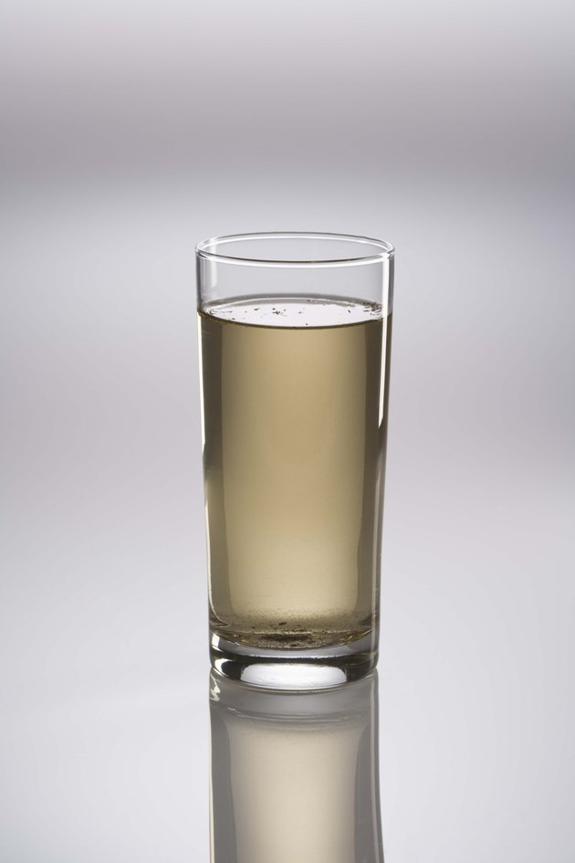 Glass of dirty water