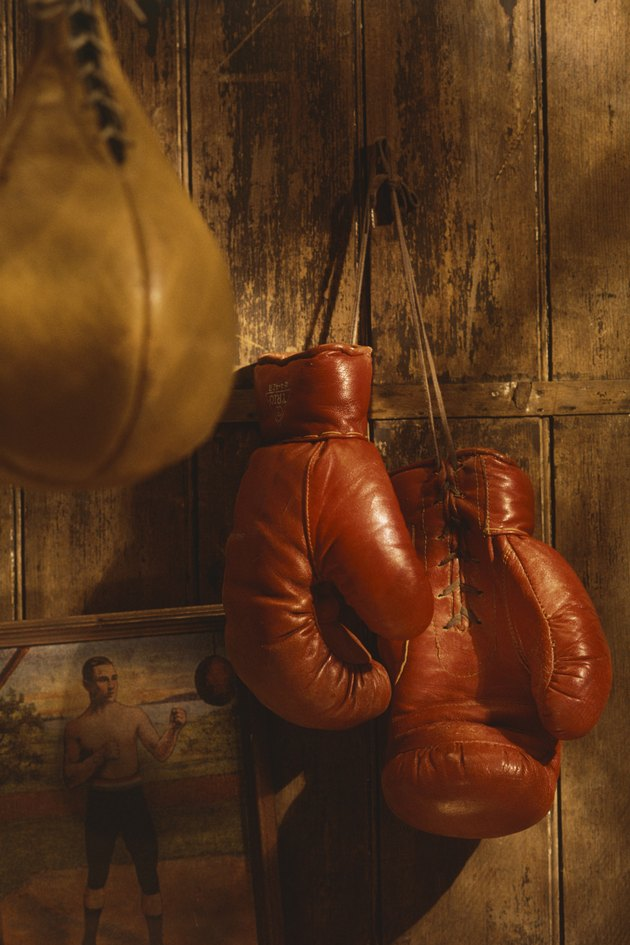 Boxing gloves hanging from wall