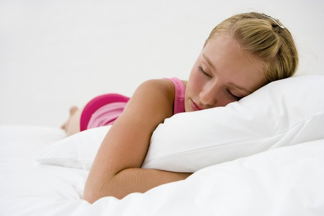 Girl sleeping with pillow