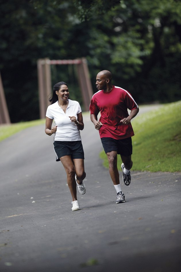 Couple jogging on path