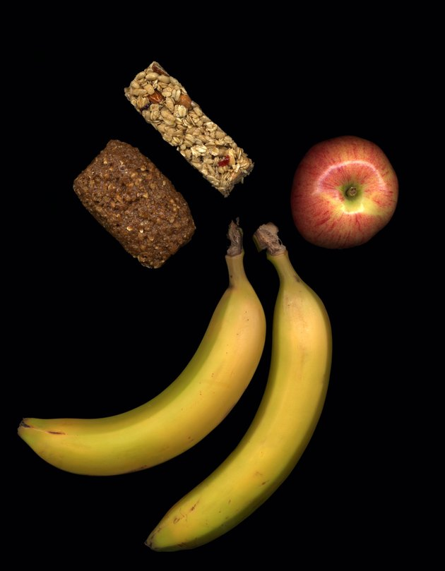 Fruit and healthy snacks on black background