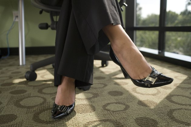 Low section view of a businesswoman sitting on an office chair