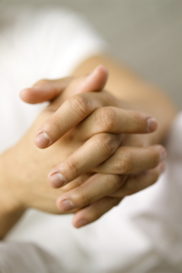 Close-up of human hands clasped