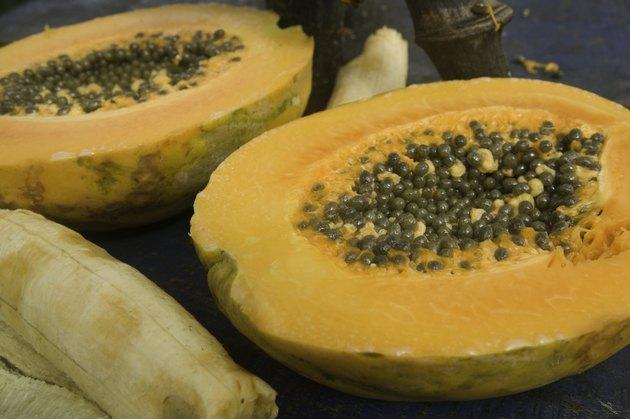 Exotic papaya fruit with seeds and banana, close-up