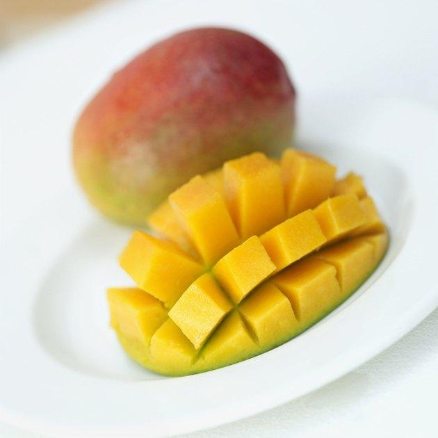 close-up of a mango slice cut into segments