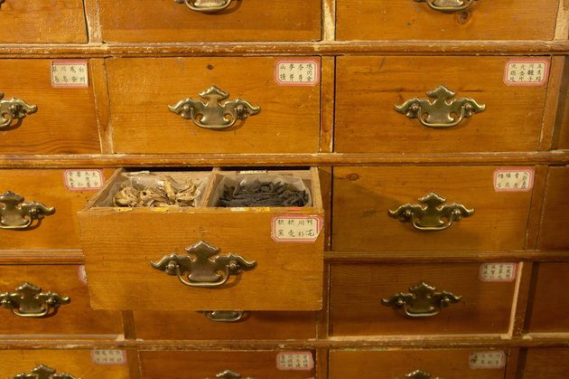 Cabinet in Chinese herb store, drawer open revealing herbs