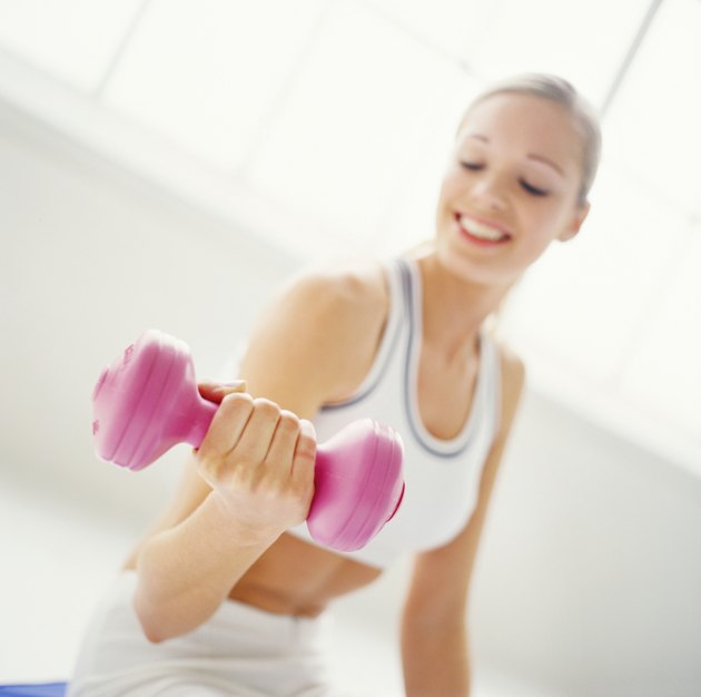 a young woman exercising with dumbbells
