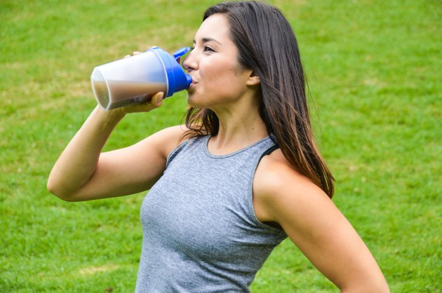 Woman drinking a meal replacement shake (protein shake)