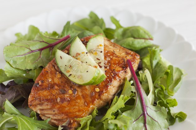 Grilled salmon over bed of spring mix salad
