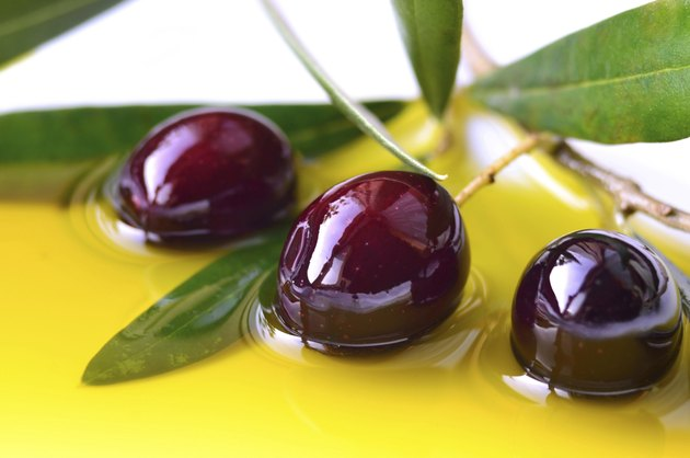 Olives and olive oil closeup