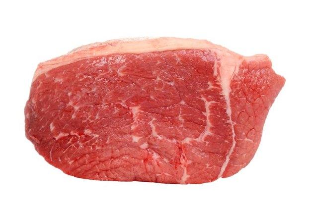 closeup outside round steak on white