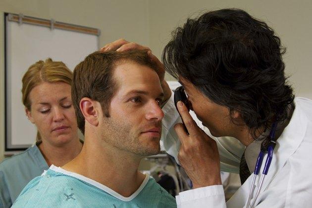 doctor doing eye examination