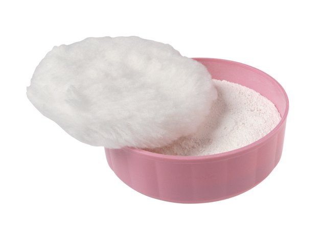 Powder puff and powder in container